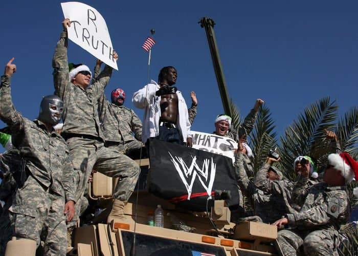 Soldiers from 4ID, MND B, cheer as WWE wrestler R Truth climbs out of their mine resistant ambush protective vehicle and takes the ring during the Tribute to the Troops Tour in front of Al Faw Palace.