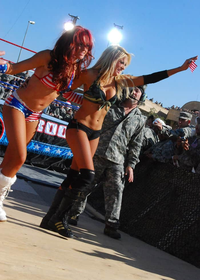 World Wrestling Entertainment Divas Kelly Kelly and Eve, leave the ring after their fight as part of the WWE Tribute to the Troops Tour in front of the Al Faw Palace.