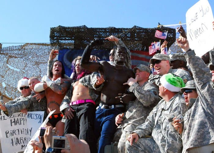 John Morrison, Jeff Hardy and R Truth, WWE wrestlers, pose with Soldiers after their fight during the Tribute to the Troops Tour, in front of the Al Faw Palace.