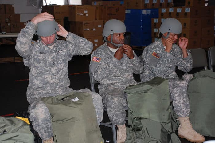 North Carolina Army National Guard 30th HBCT soldiers try on protective helmets for proper fit at Camp Shelby Joint Forces Training Center.