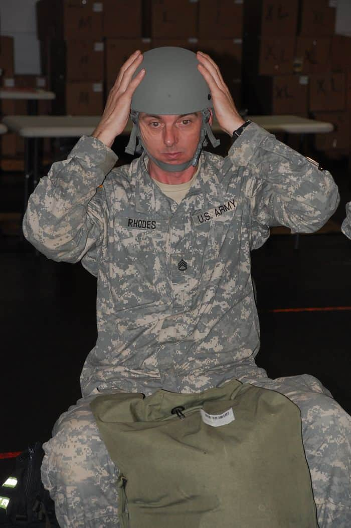 Staff Sgt. Henry Rhodes, a Sanford, N.C. resident tries on a helmet during the Rapid Fielding Initiative Issue process.
