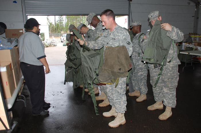 North Carolina Army National Guard Soldiers stand in line during their Rapid Fielding Initiative Issue process at Camp Shelby.