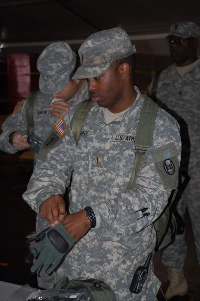 2Lt. Darius White, tries on protective gloves during the Rapid Fielding Initiative Issue process at Camp Shelby Joint Forces Training Center.