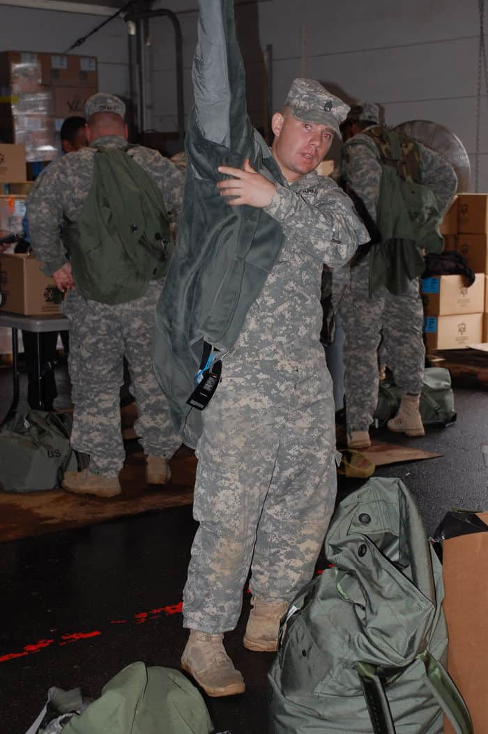 Staff Sgt. Jason Wood, 30th HBCT, Echo Company 252 Combined Arms Battalion, tries on a winter coat during the Rapid Fielding Initiative Issue process at Camp Shelby Joint Forces Training Center.