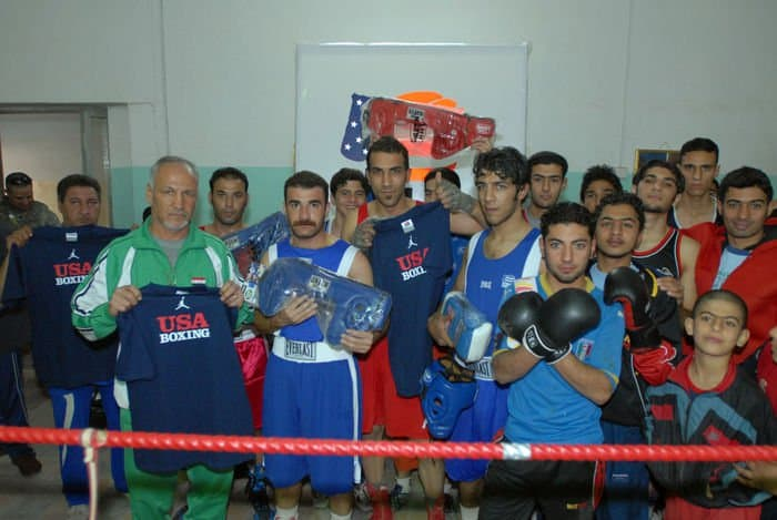 Two time Olympian Farouk Changchun and the Iraqi boxers he trains pose with gear donated by USA Boxing for the reopening of the Adhamiyah Sports Complex in northeast Baghdad. Changchun represented Iraq in the 1976 and 1980 Olympic Games.