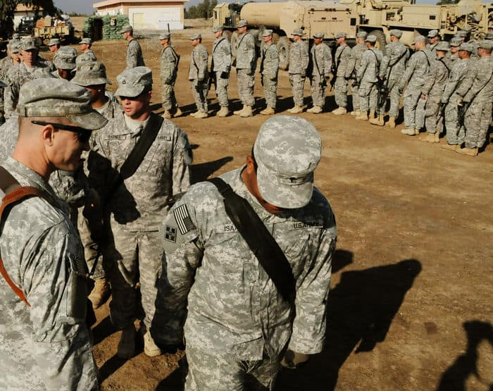Soldiers from Troop C, 1 10 Cav. Regt., line up to receive their combat patches during a ceremony at PB Mahawil in Babil Province.