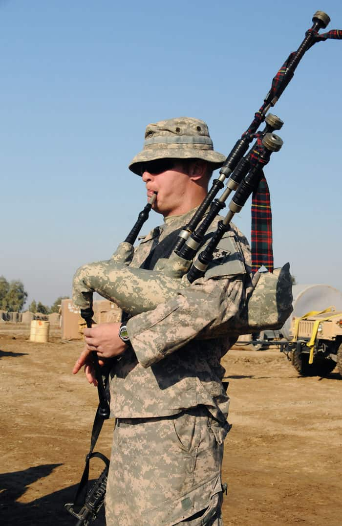 Pfc. Charles Ford, cavalry scout, Troop C, 1 10 Cav. Regt., plays The Masons Apron on the bagpipes during a combat patch ceremony at PB Mahawil in Babil Province.