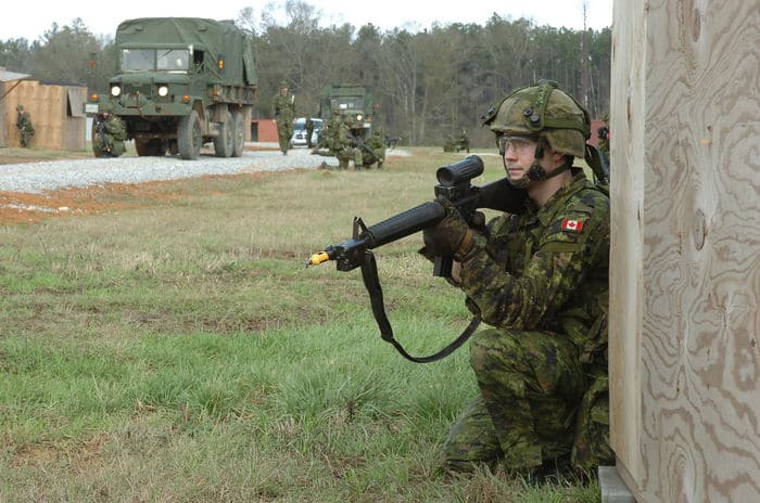 Pvt. Steven Demers, a rifleman with the Canadian Forces 6th Battalion, Royal 22nd Regiment, scans his sector for enemy activity during Counter IED training as part of Operation Noble Guerrier at CSJFTC.