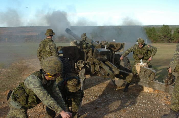 An artillery crew of the Canadian Forces GPE Artillerie Artillery Training Group fires the C 2 105mm howitzer during Operation Noble Guerrier at CSJFTC.