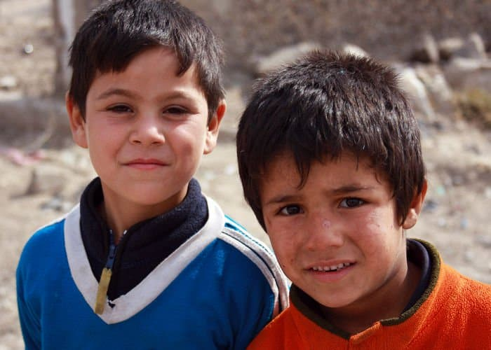 Local Iraqi children smile for the camera during a dismounted patrol in the Doura community of southern Baghdad.