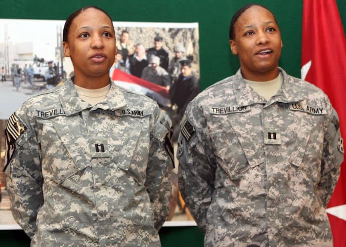 Captains, and identical twin sisters, Belinda and Brenda Trevillion, of Sacramento, Calif., protocol officers of 4ID and 1st Cavalry Division spoke at the Ironhorse Division monthly town hall broadcast.