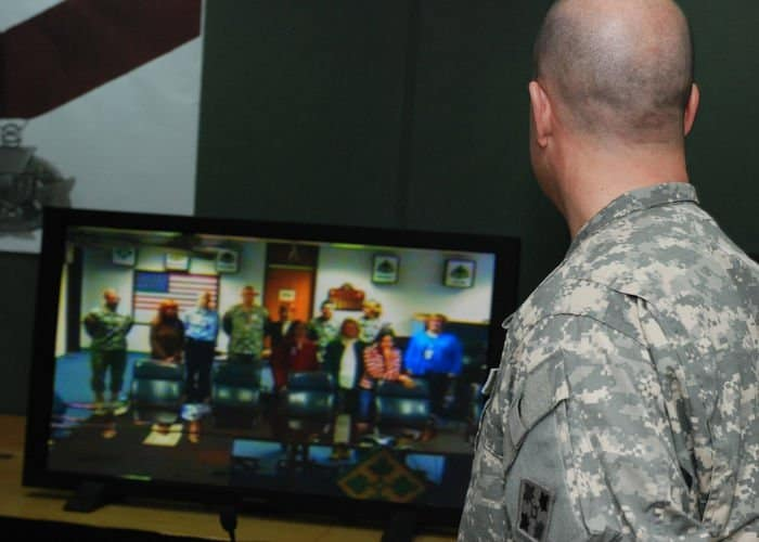 Lt. Col. David Ristedt, of Logansport, Ind., 4ID division surgeon, videoconferences his family in Fort Hood, Texas.