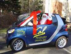 Father Christmas sitting in a car.