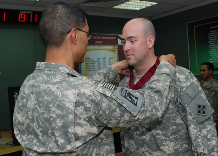 Lt. Col. David Ristedt, of Logansport, Ind., 4ID division surgeon, MND B, presented the Order of Military Medical Merit by Brig. Gen. Joseph Caravalho, from Kaneohe, Hawaii, surgeon general, MNF Iraq.