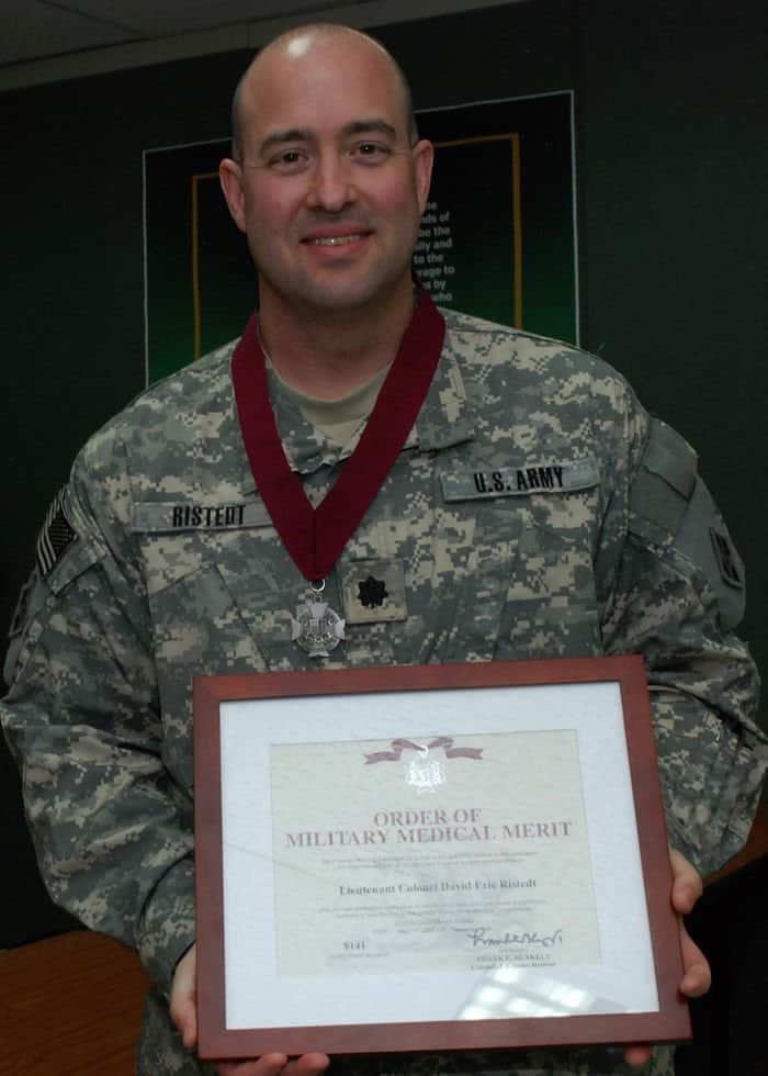 Lt. Col. David Ristedt, 4ID division surgeon, after being presented the Order of Military Medical Merit by Brig. Gen. Joseph Caravalho.