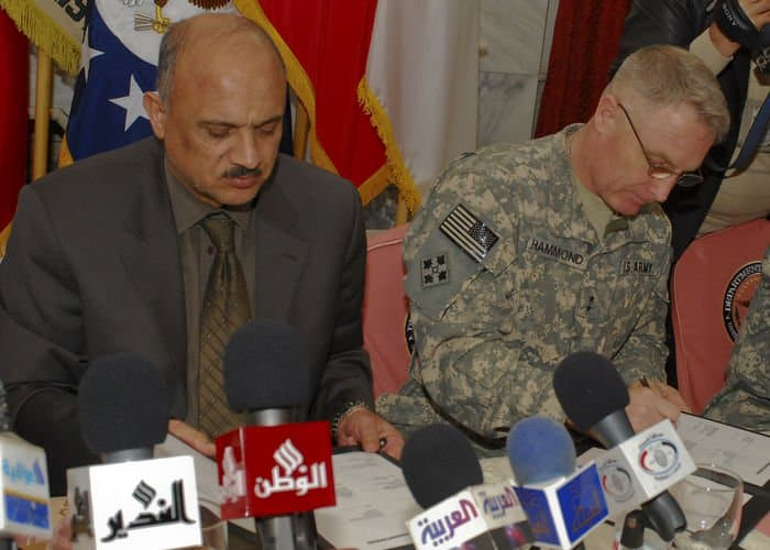 Hussein Al Tahan governor of Baghdad and Maj. Gen. Jeffery Hammond, commanding general of 4th MND B and the 4ID, sign a memorandum of understanding at FOB Blackhawk.