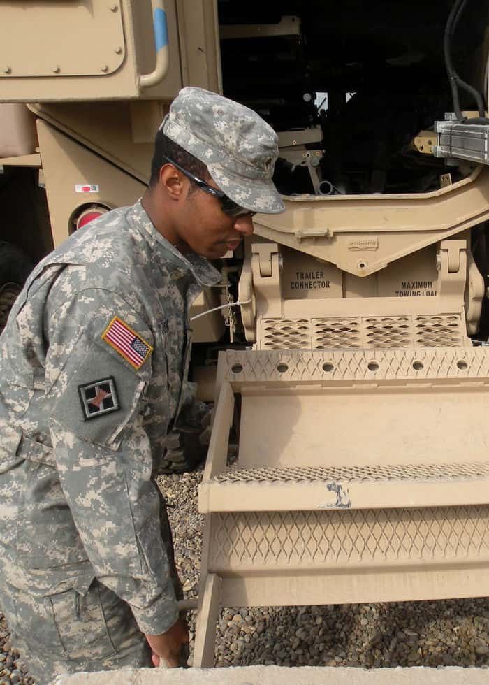 Spc. Xylon Morgan, a native of Hattiesburg, Miss., demonstrates how the steps operate on the heavily armored ground ambulance