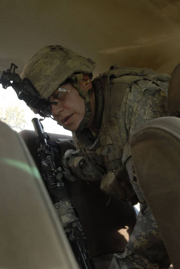 Spc. Mack Pinson, a cavalry scout from Lincoln Park, Mich., assigned to Troop C, 7th Squadron, 10th Cavalry Regiment, 1st Brigade Combat Team, 4ID, MND B, searches a car at a traffic control point in the Abu Tshir community of the Rashid district in southern Baghdad