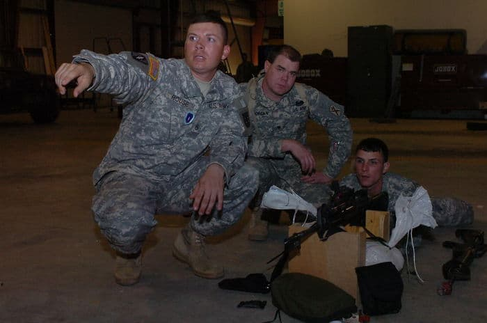 Staff Sgt. Mark Rouse, left, instructs 11B MOST students Spc. Scotty Jordan, center, and Pvt.2 Nicholas Bourque on how to zero a rifle using a laser boresighter during training at CSJFTC.