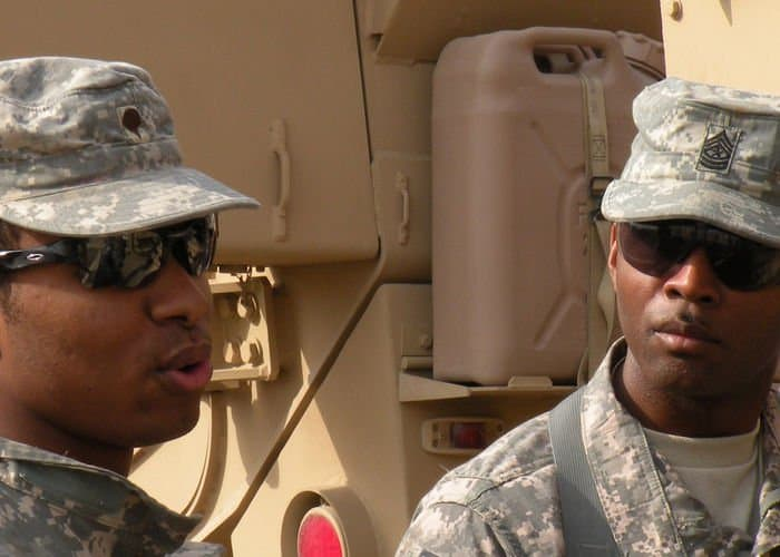 Spc. Xylon Morgan, of Hattiesburg, Miss., and Sgt. Maj. Antez Gilbert, of Atlanta, Ga., discuss the differences on the new heavily armored ground ambulances being used in theater