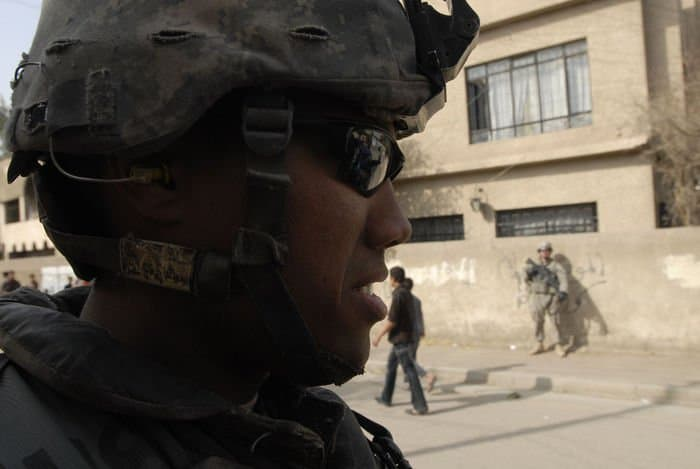 Spc. Nelson Vasquez, a cavalry scout from Nelson, Calif., assigned to the Troop C, 7th Squadron, 10th Cavalry Regiment, 1st Brigade Combat Team, 4ID, MND B, maintains a vigilant eye for potential threats during security patrols in the Abu Tshir community of the Rashid district in southern Baghdad.