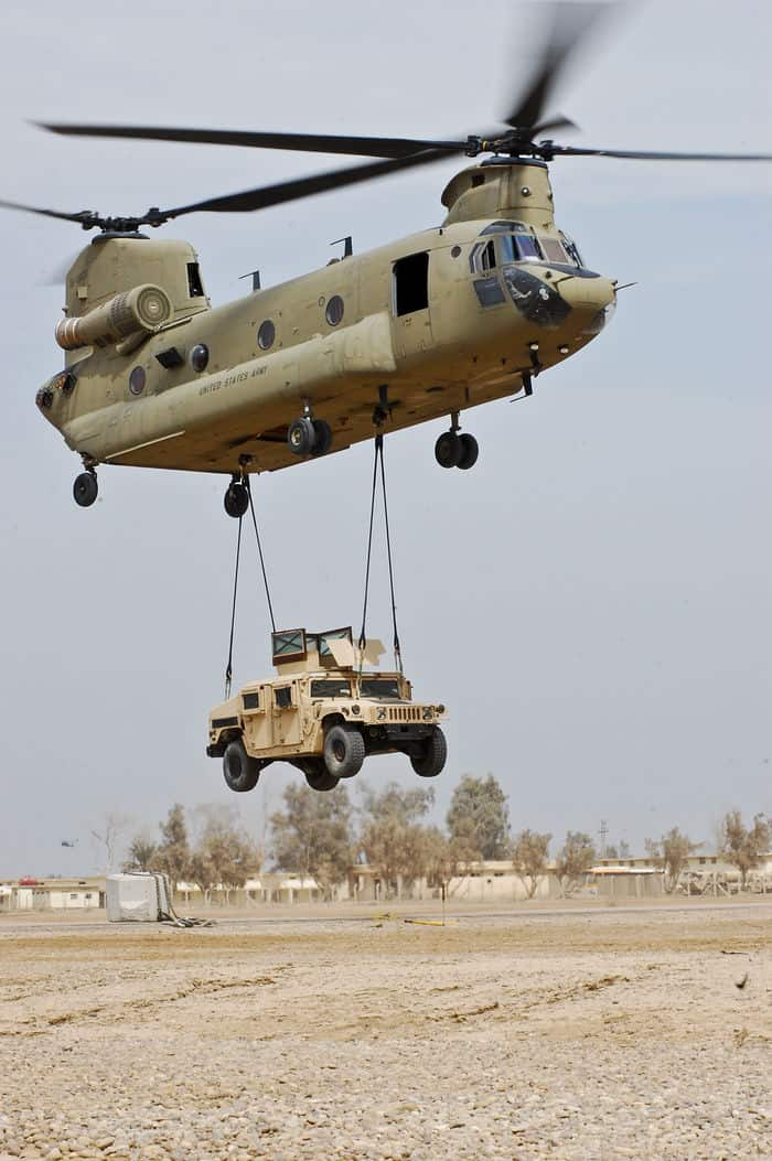 A CH 47F Chinook cargo helicopter from the 2nd Battalion, Combat Aviation Brigade, 4ID, Multi National Division Baghdad, lifts a humvee off the ground during a sling load certification course at Camp Taji.