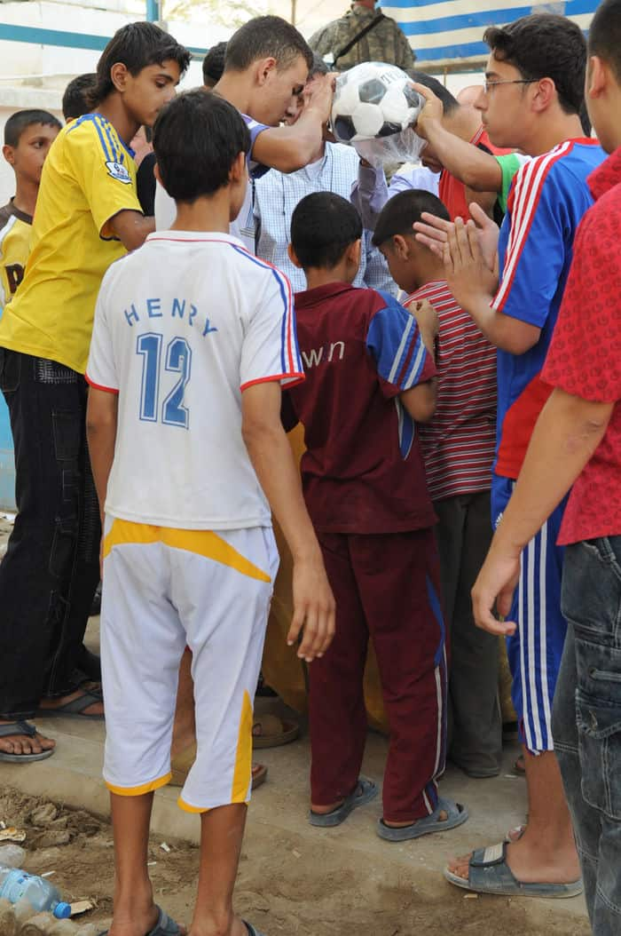 Iraqi children receive soccer balls during a humanitarian mission in the Rusafa district of Baghdad.