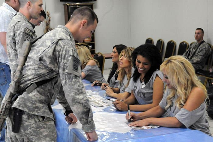 Paratroopers assigned to 82nd Airborne Division, get autographs from the NFL Oakland Raiders cheerleaders at Joint Security Station Loyalty.