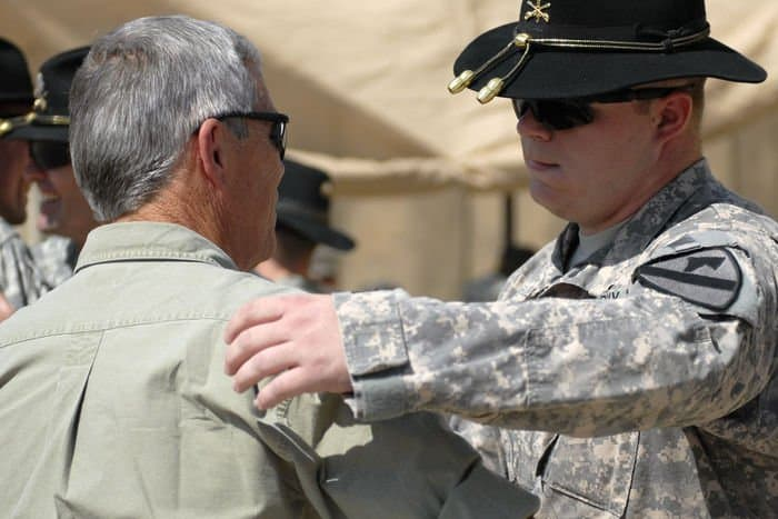 Cpt. Jeffrey Hendrix hugs his father, retired Army Lt. Col. Thomas Hendrix, after he relinquished command of B. Co., 3rd Bn., 8th Cav. Regt.