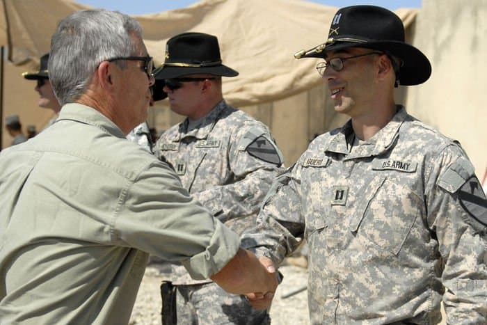 Cpt. Shane Aguero shakes hands with retired Army Lt. Col. Thomas Hendrix after he assumes command of B. Co., 3rd Bn., 8th Cav. Regt.