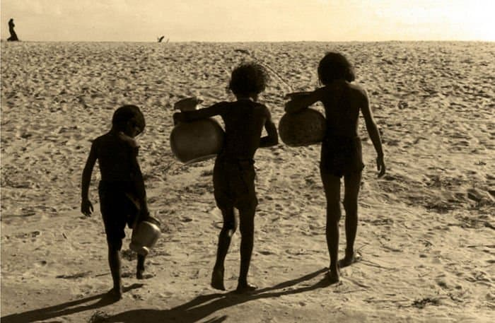 Children carry drinking water