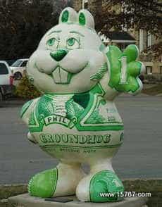 A 6 ft tall Phil statue near a bank.