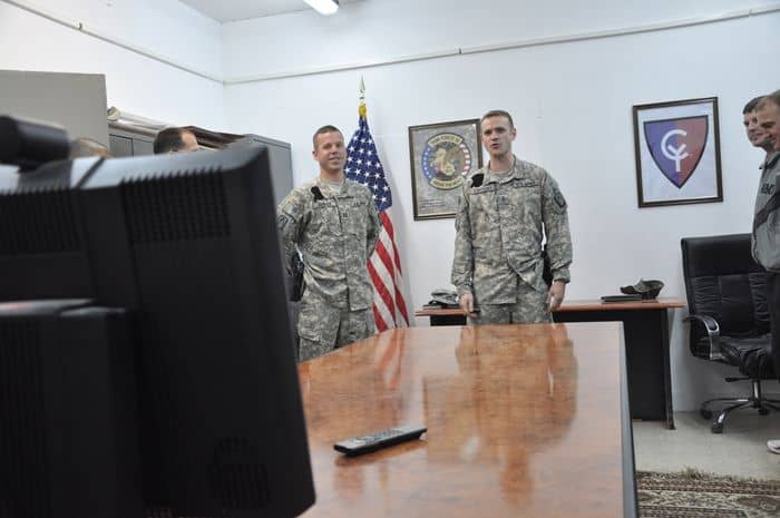 Chief Warrant Officer 3 Lee Kokoszka, C Company, 3rd Battalion, 158 Aviation Regiment, talks to his wife and daughter in Germany through a video teleconference after his promotion ceremony at Joint Base Balad, Iraq.