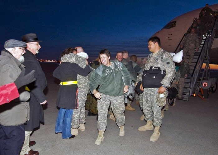 Soldiers of the Army Reserve 542nd Quartermaster Company are greeted with smiles and hugs at the Indianapolis International Airport.