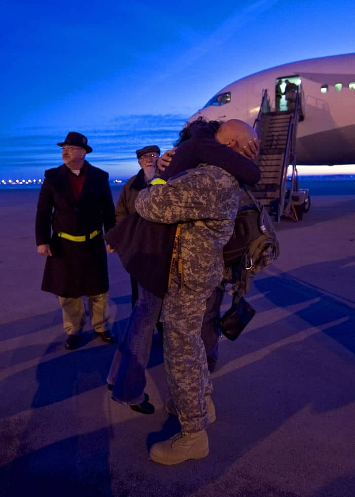 A Soldier hugs a loved one at the Indianapolis International Airport.