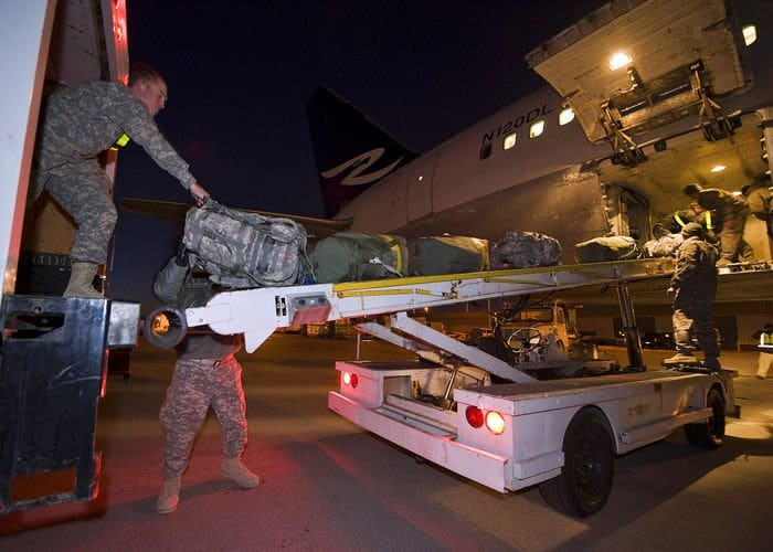 Soldiers of the Army Reserve 542nd Quartermaster Company, out of DuBois, Pa., unload baggage after returning from a year long deployment to Iraq.
