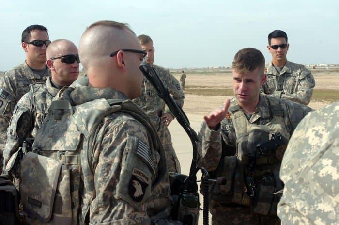 Lieutenant Colonel David Francis, battalion commander and UH 60 Black Hawk pilot, 2nd Battalion, 25th Aviation Regiment, Task Force Diamond Head, 25th Combat Aviation Brigade, conducts a final mission brief with Black Lions infantrymen.