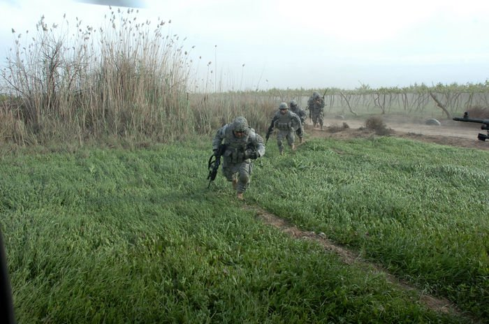 A squad of infantryman with 1st Battalion, 28th Infantry Regiment Black Lions, 1ID, fight rotor wash as they are extracted from a landing zone.