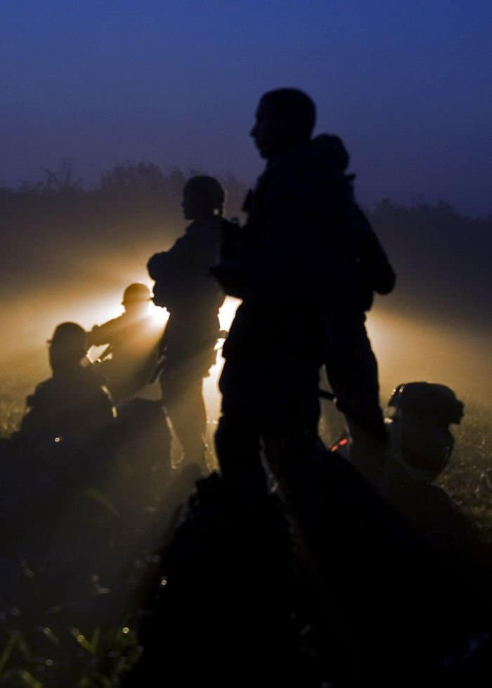 Servicemembers of a Provincial Reconstruction Team prepare in the early morning hours for mobilization training.