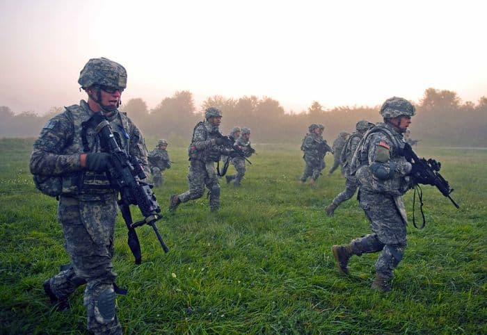 Soldier and Airmen of Provincial Reconstruction Team Kapisa sprint 500 meters across a range at Camp Atterbury.