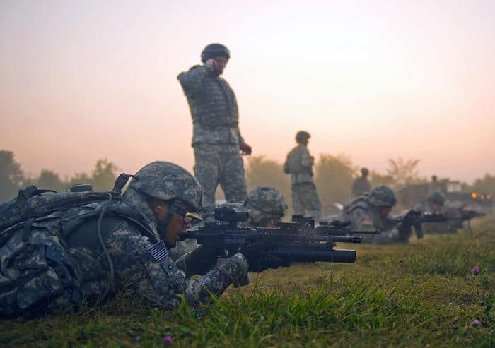 Soldiers and Airmen fire their weapons together on the stress fire range at Camp Atterbury.