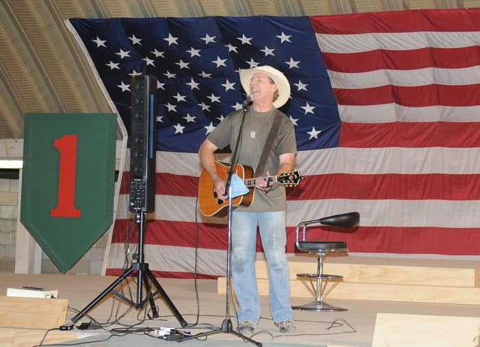 Country music artist Michael Peterson performs a song for Soldiers and Department of the Army civilians assigned to United States Division South at the USD S Resiliency Campus stage in Basra.