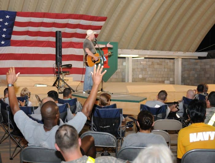 Country music artist Michael Peterson gets a reaction during a break between sets at the United States Division South Resiliency Campus stage in Basra.