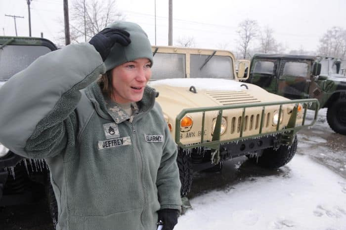 Staff Sgt. Sarah Jeffrey of Indianapolis, Indiana warms up a Humvee for a support mission during the winter storm in Shelbyville, IN.