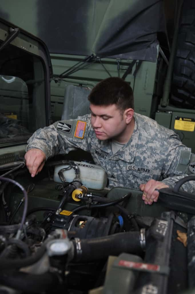 Sgt. Daniel Wright pulls last minute maintenance at the Greenfield armory while preparing to support response missions during a winter ice storm in central Indiana.