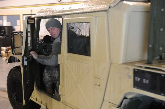 Sgt. First Class Michael Price of Cloverdale, Indiana, prepares a Humvee for support missions during the winter storm in Shelbyville, IN.