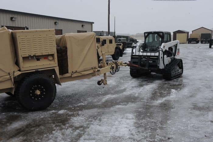 Sgt. Tim Turner of Shelbyville pulls out a generator in preparation for support mission during the winter storm in Shelbyville, IN.
