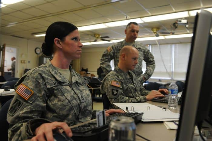 Staff Sgt. Kerri Pipper of Franklin, Indiana sits in the operations center in Shelbyville, IN, as she helps prepare for support missions by establishing communications and coordination with the Highway Assistance Teams during the winter storm.