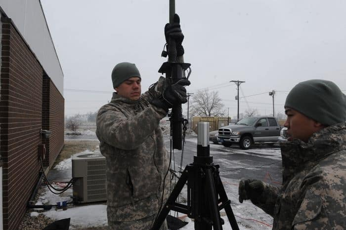 Staff Sgt. Joseph Magers of Greenville, Indiana and Chief Warrant Officer Three Shad Harth of Speedway, Indiana, set up a communication antenna at the Shelbyville Armory in support of the winter storm.