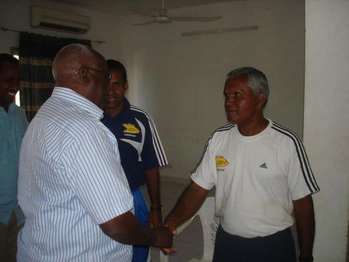 Somali NOC president shakes hands with IAAF lecturer Sereve Joel